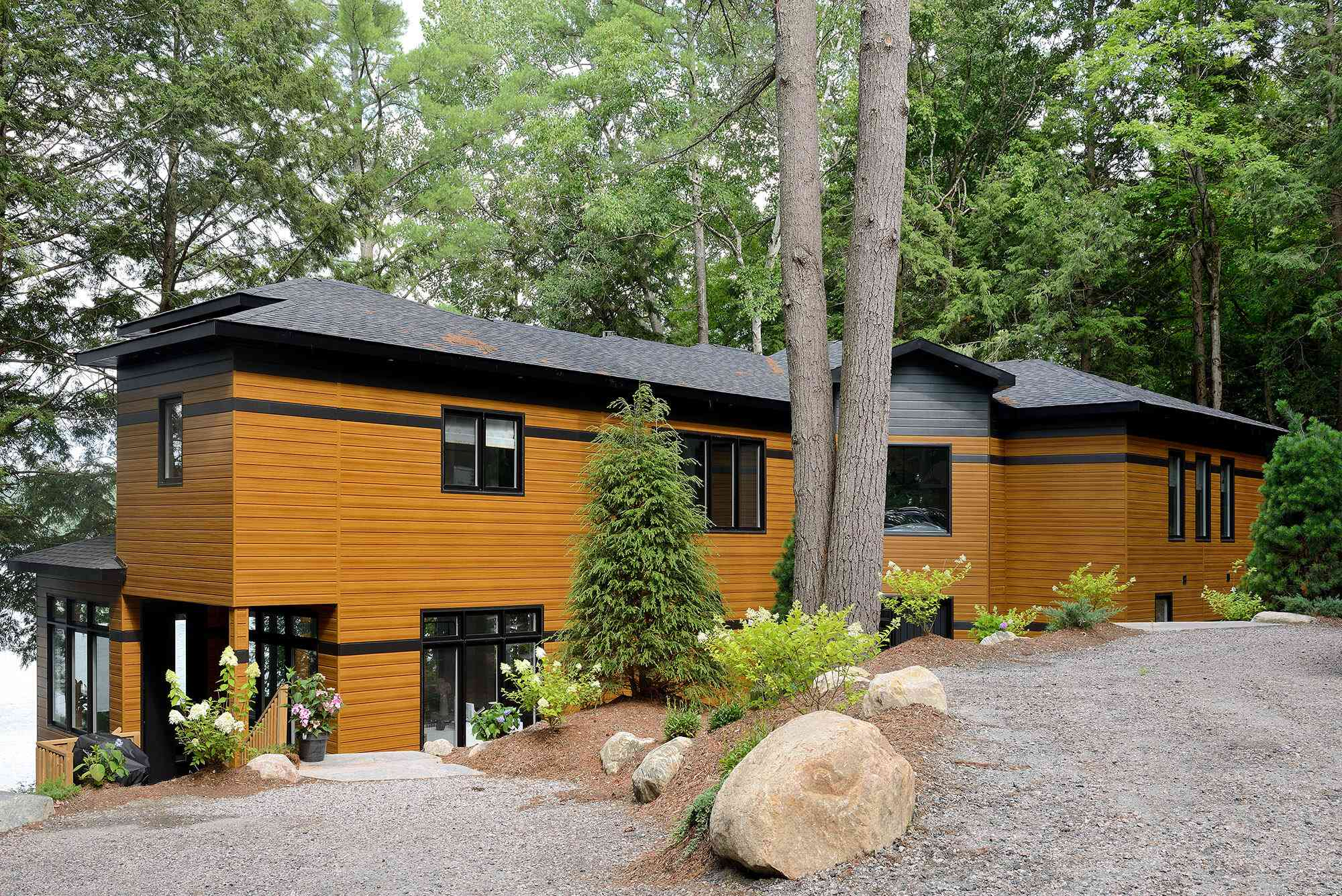 Cabin exterior with evergreen trees.