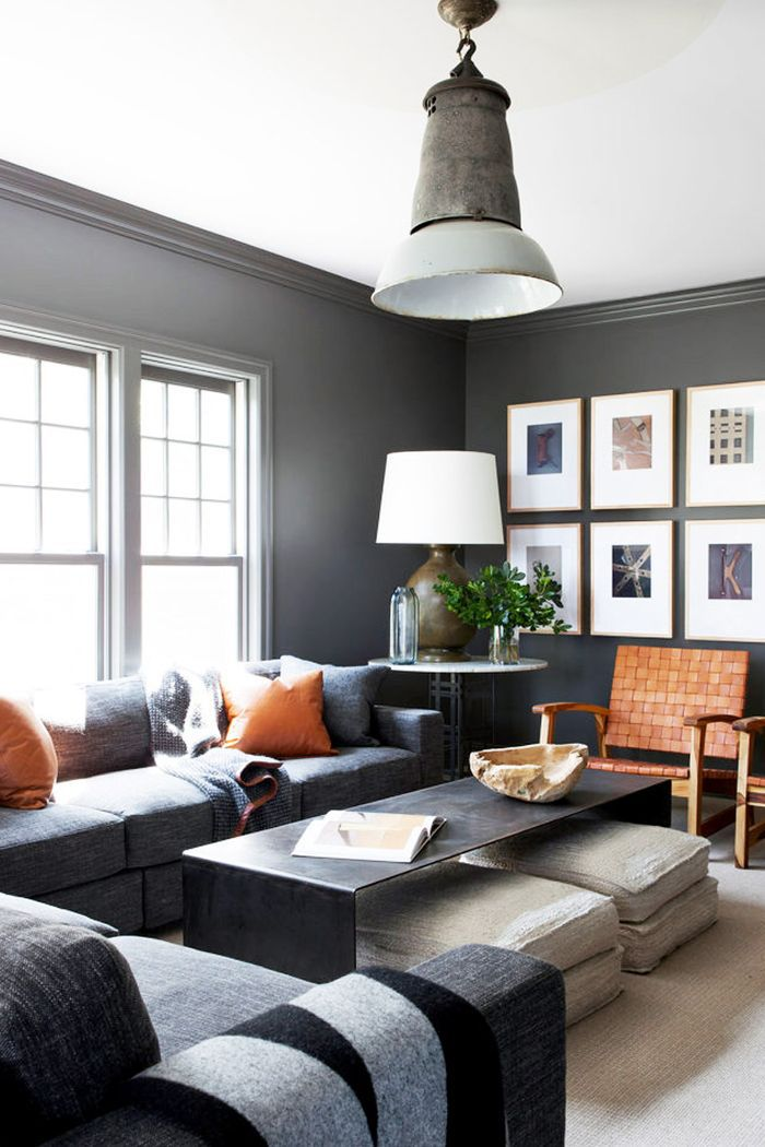 A gallery wall brightens up dark-colored walls