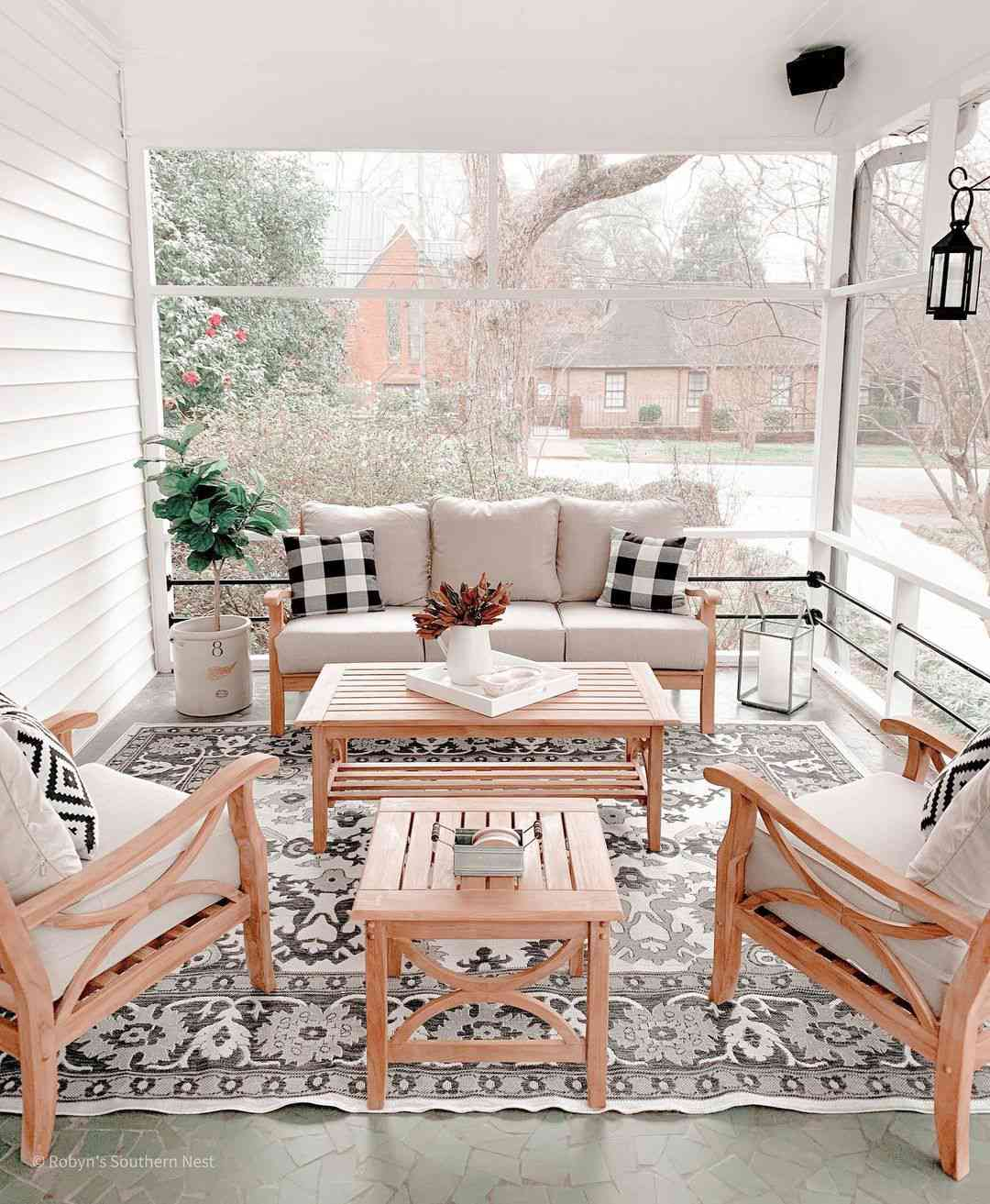 Screened in porch with furniture
