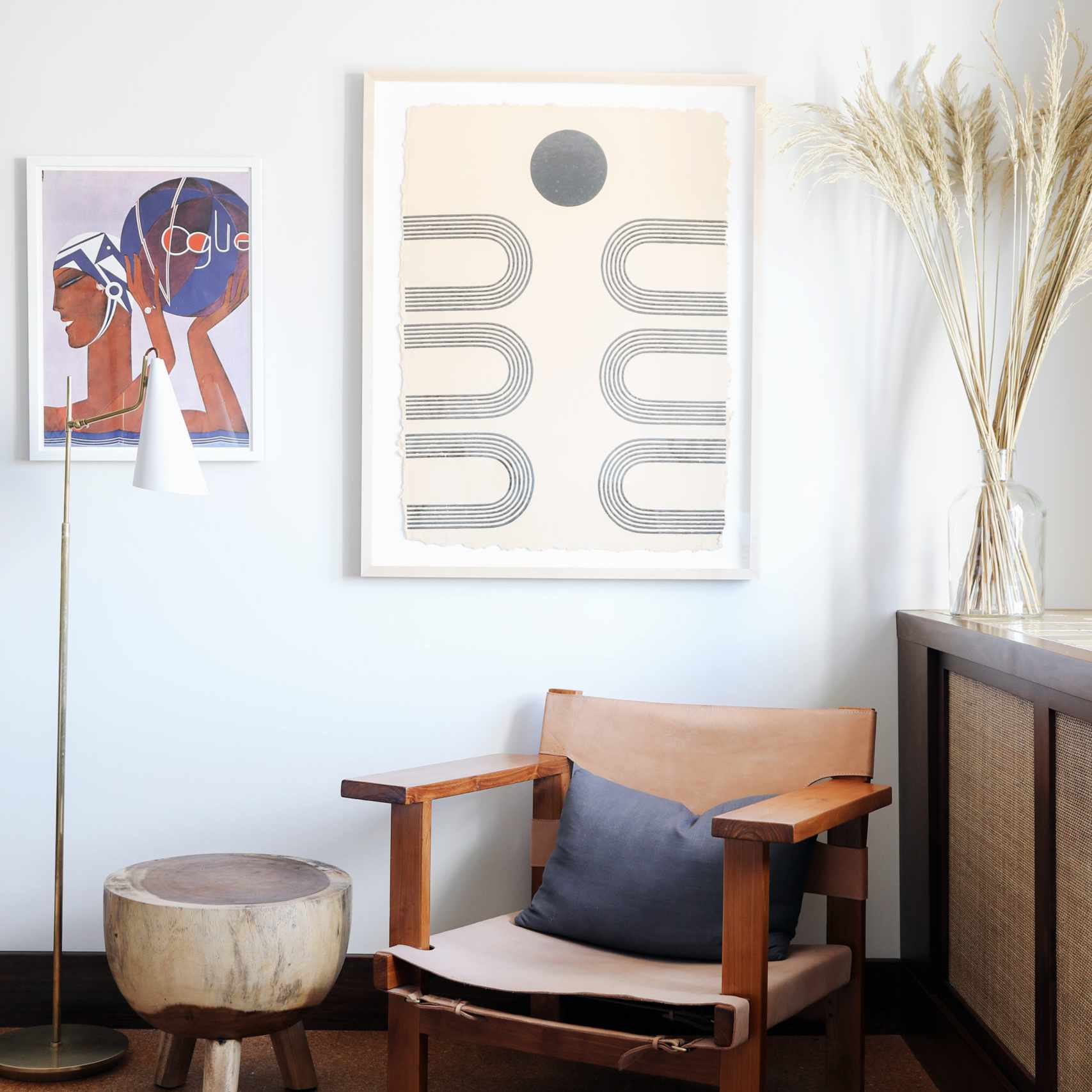 minimalist room with vintage chair and art