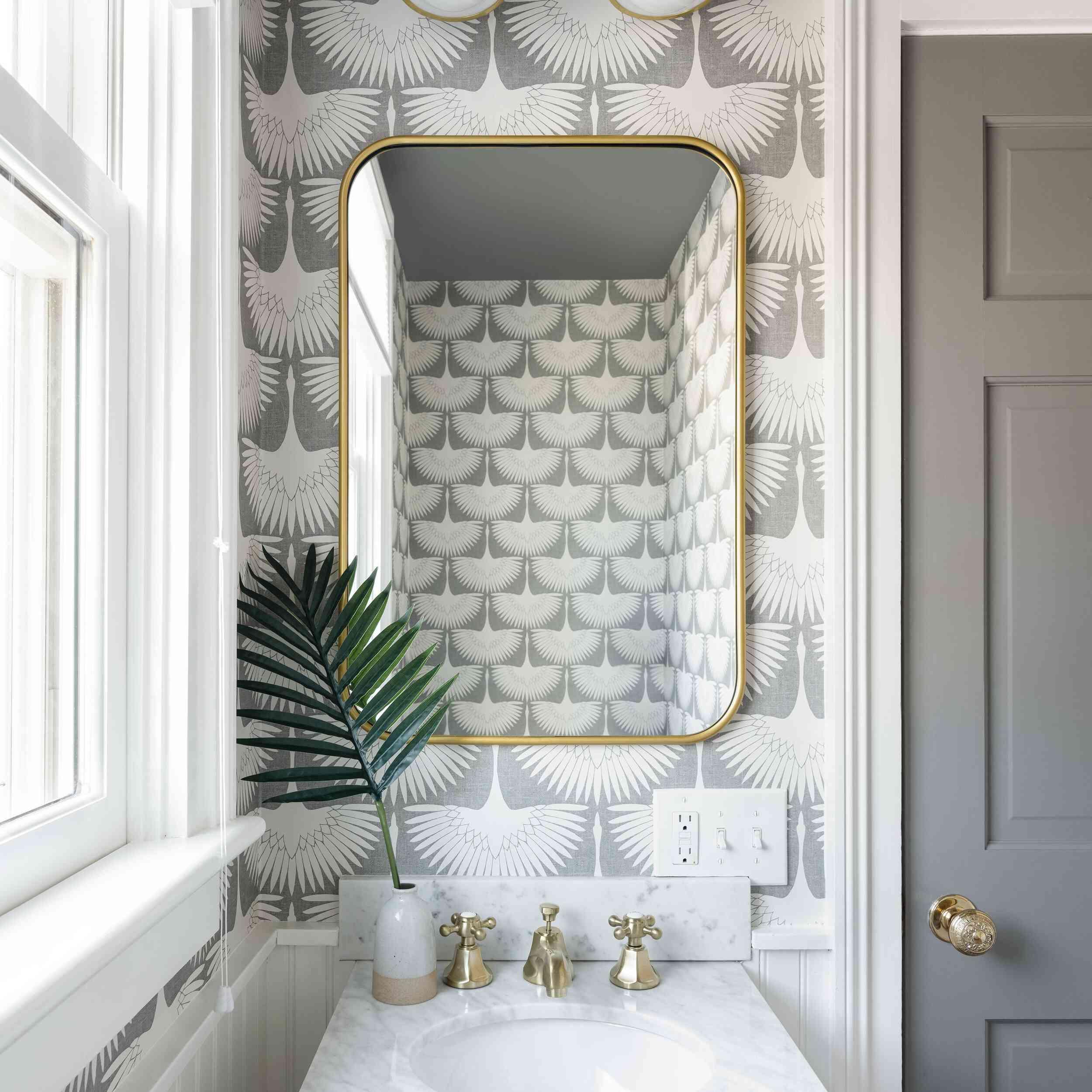 Bathroom with metallic wallpaper