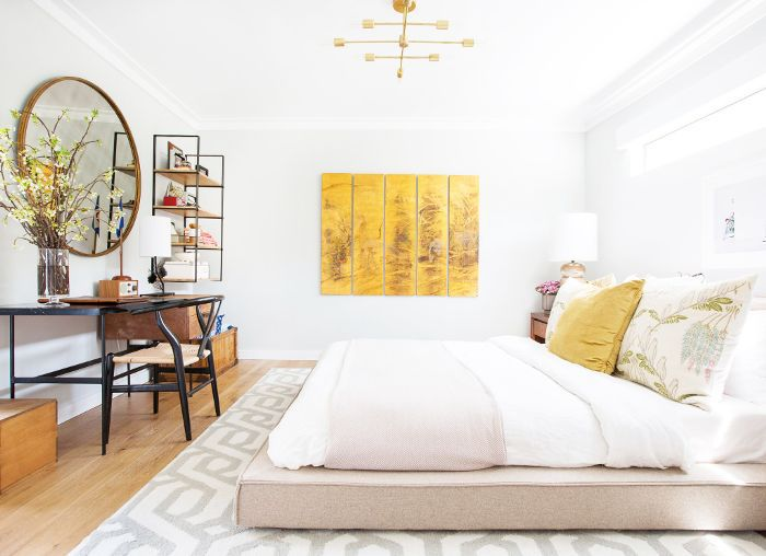 A pared-down bedroom with gold accents.