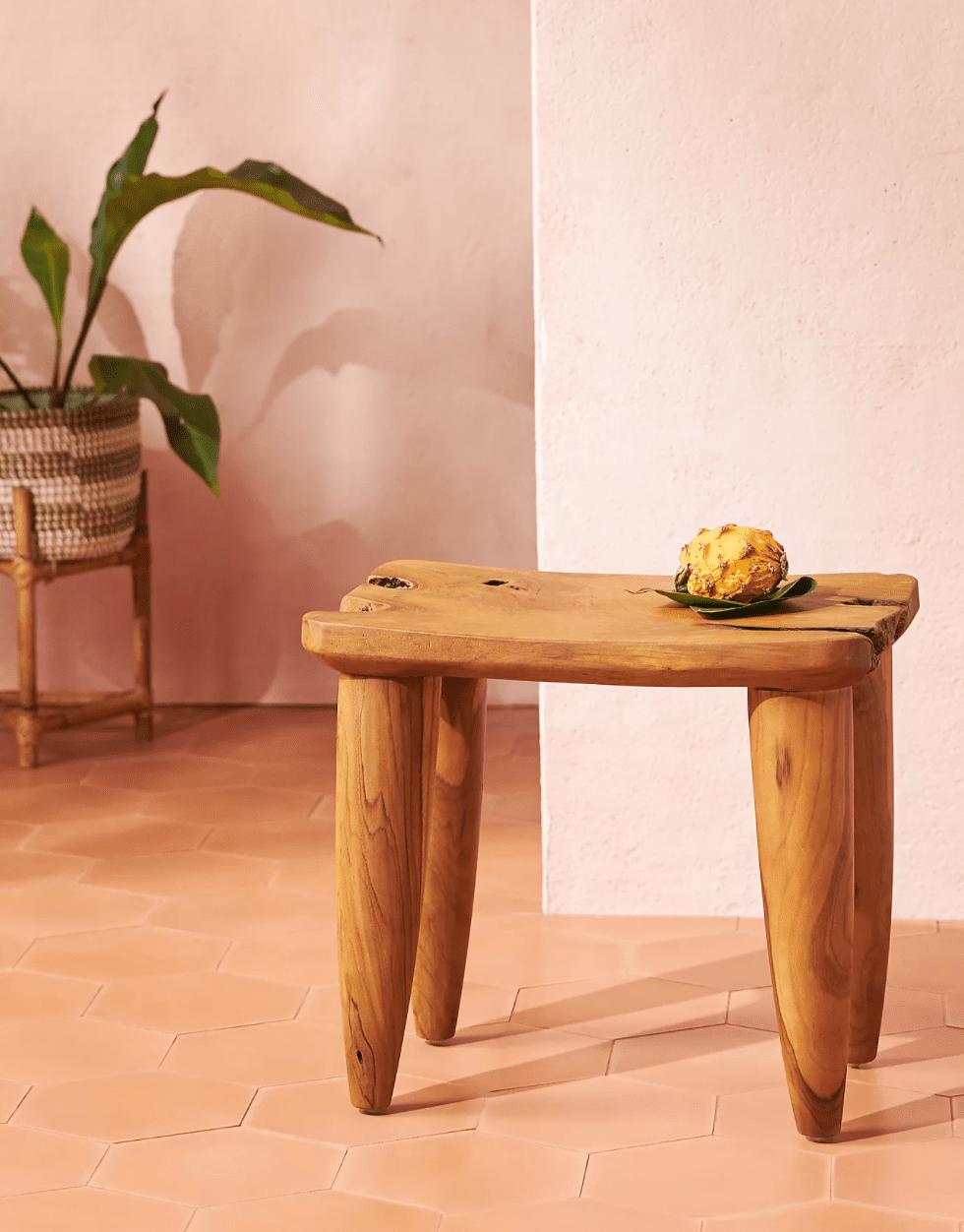 A small wooden bath stool