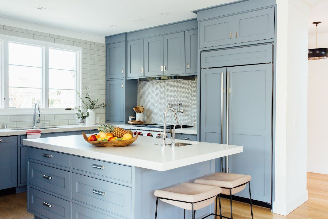 Kitchen island with drawers and bar stools