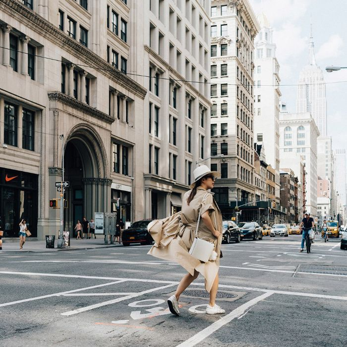 a woman walking down the street in NYC