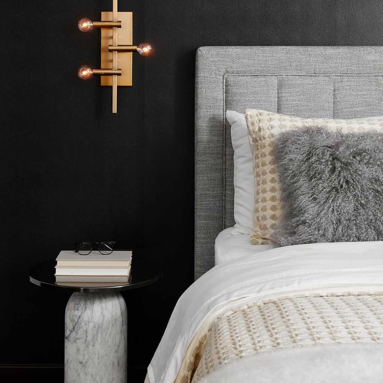 Dark gray and black bedroom with metallic accents