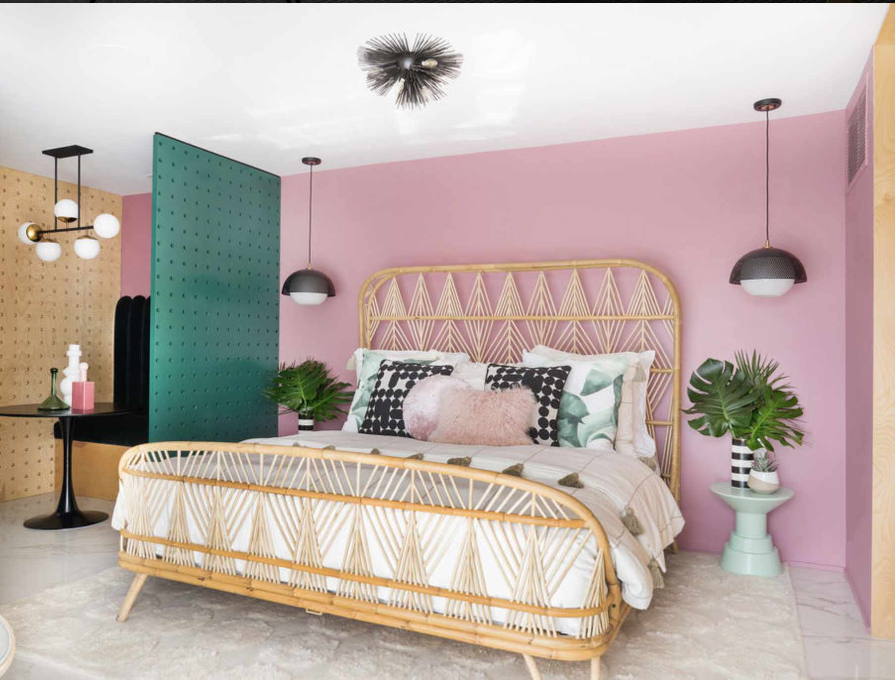 pink and teal bedroom with wicker bed frame