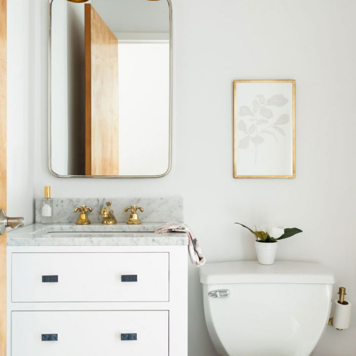 Small bathroom with bin under the sink for storage