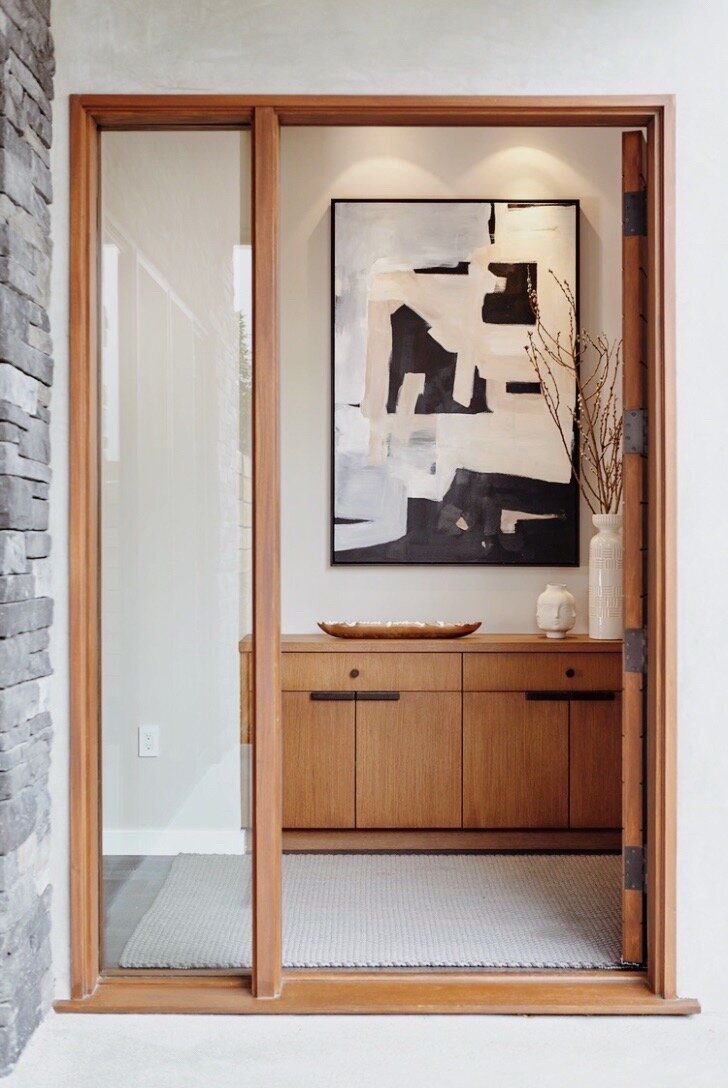 A hallway adorned with a bold work of abstract art