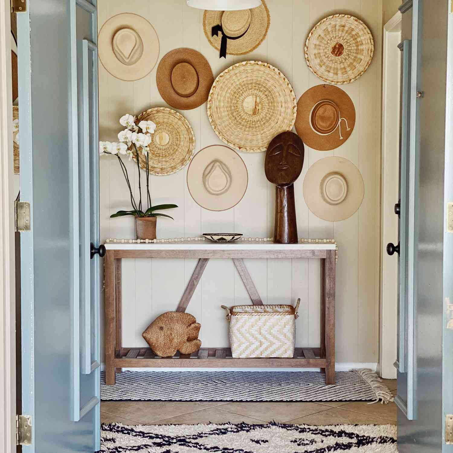Boho chic entryway styled with woven elements and cultural decor