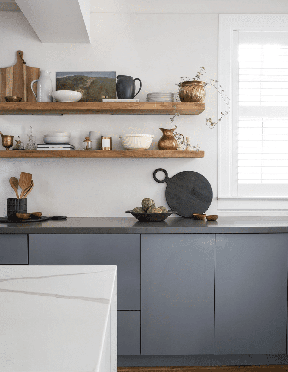 A minimalist kitchen with crisp white walls