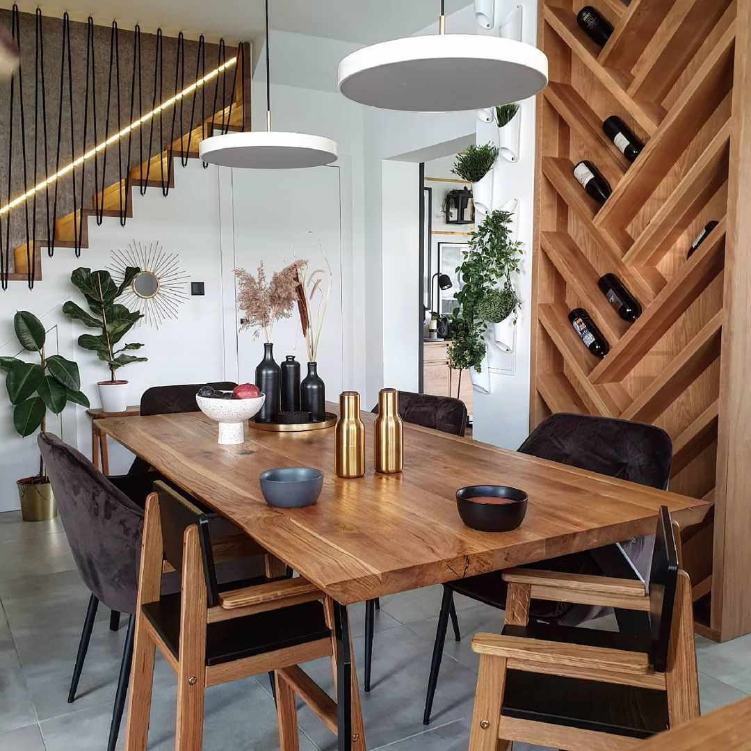 A dining room with beautiful wine storage