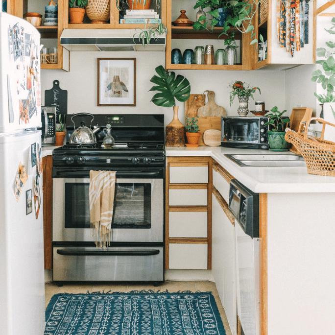 Blue kitchen rug in white kitchen