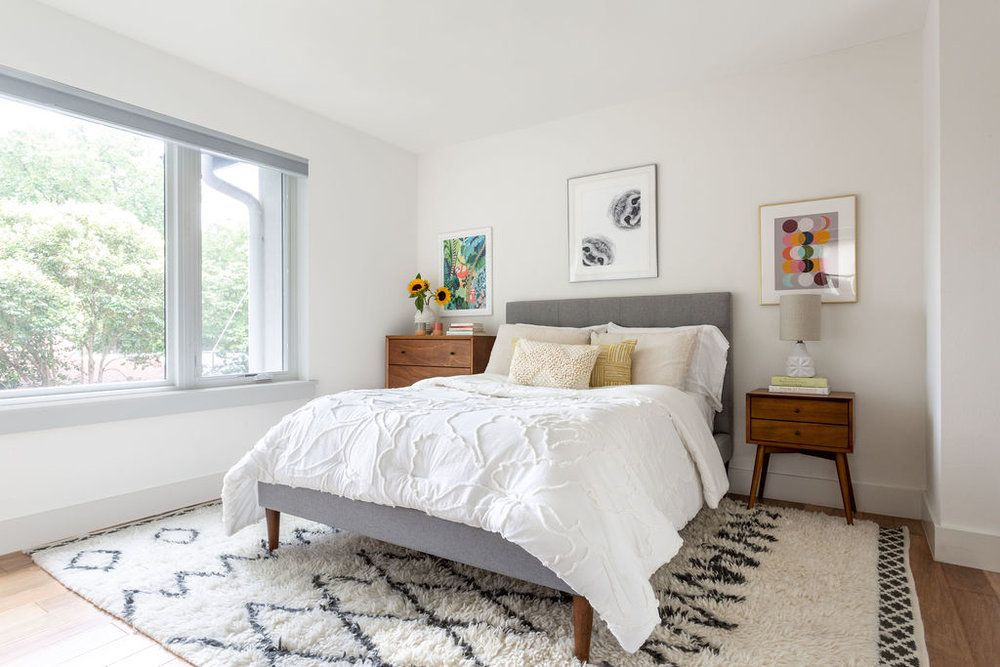 bedroom with cozy patterned rug