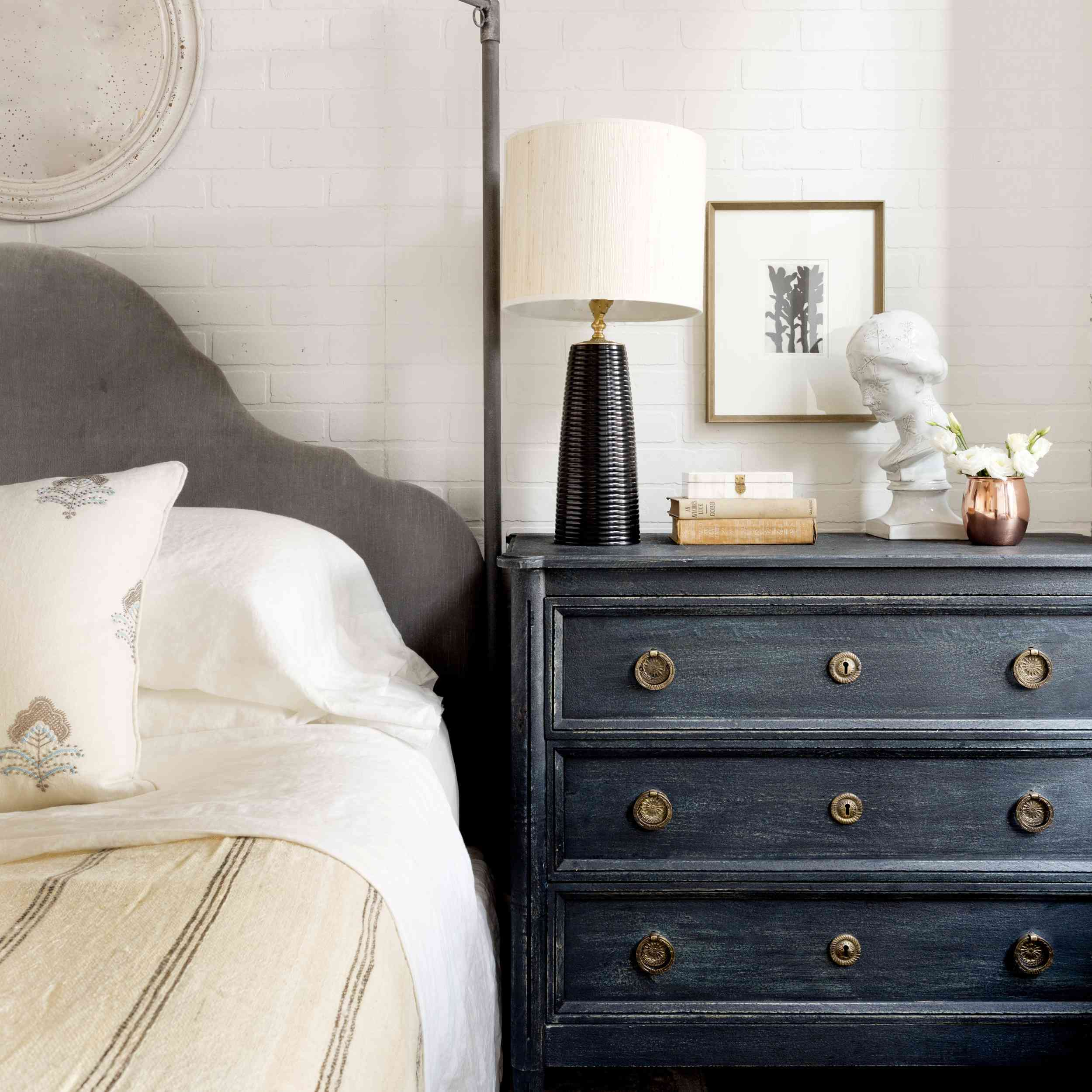 A bedroom with a large indigo nightstand
