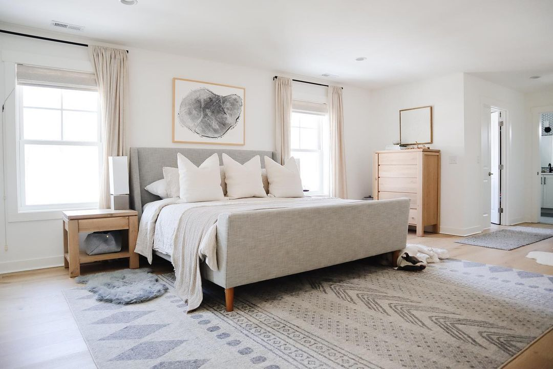 Soft bedroom with neutral nightstand.