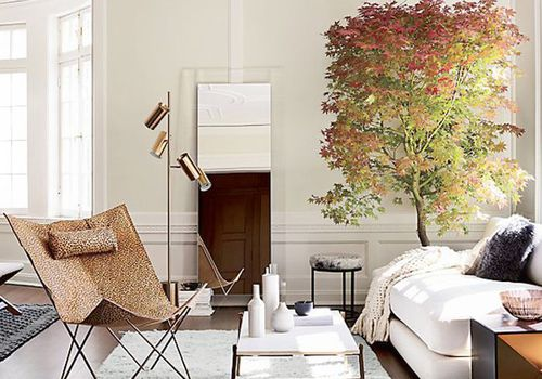 Living room with a large floor mirror
