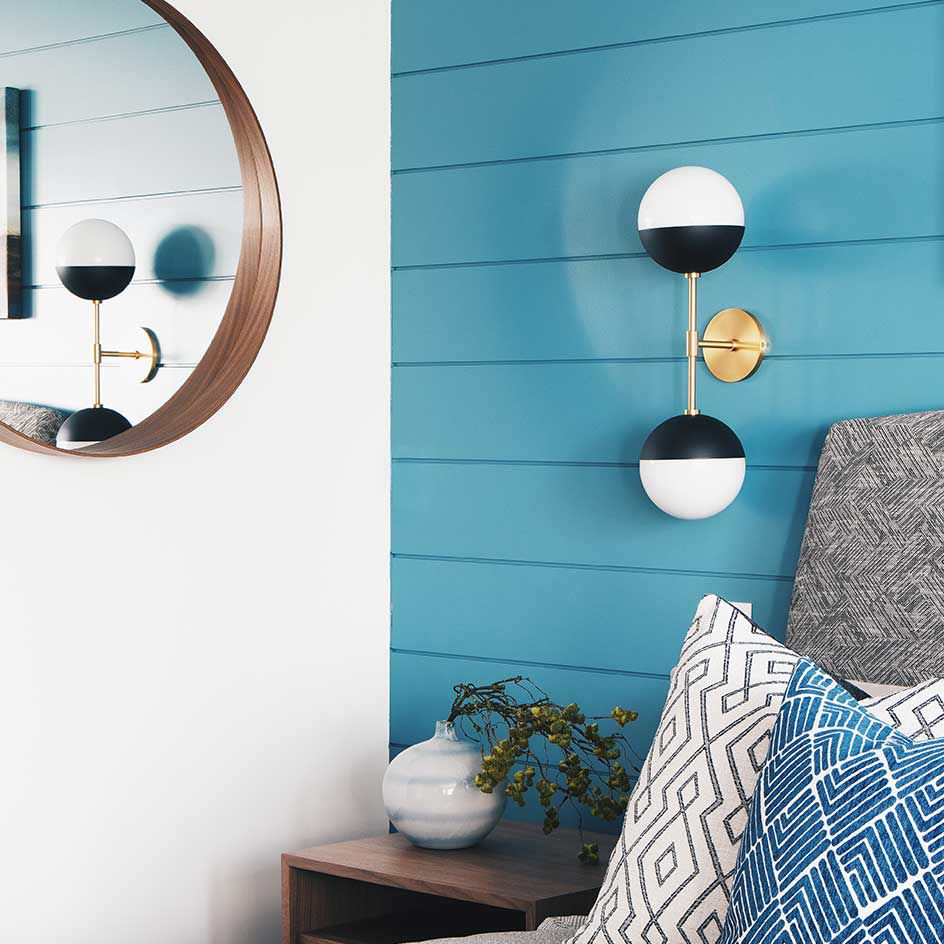 Bright teal wall with black light fixture.