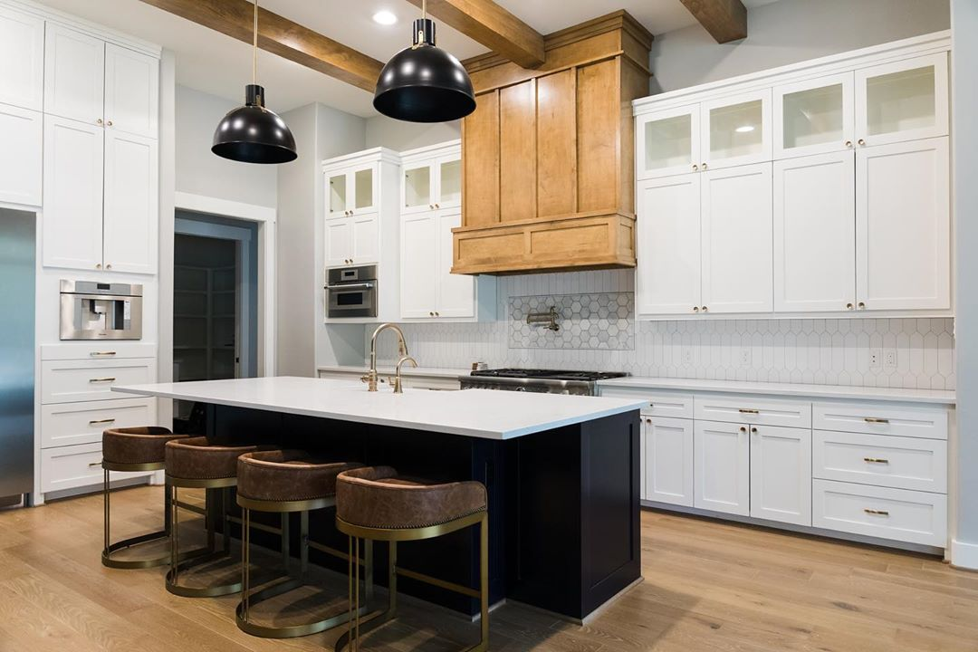 Kitchen with white and black features