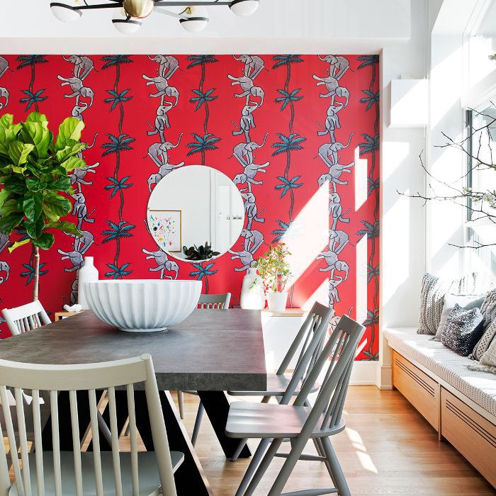Modern dinging room with bold wallpaper