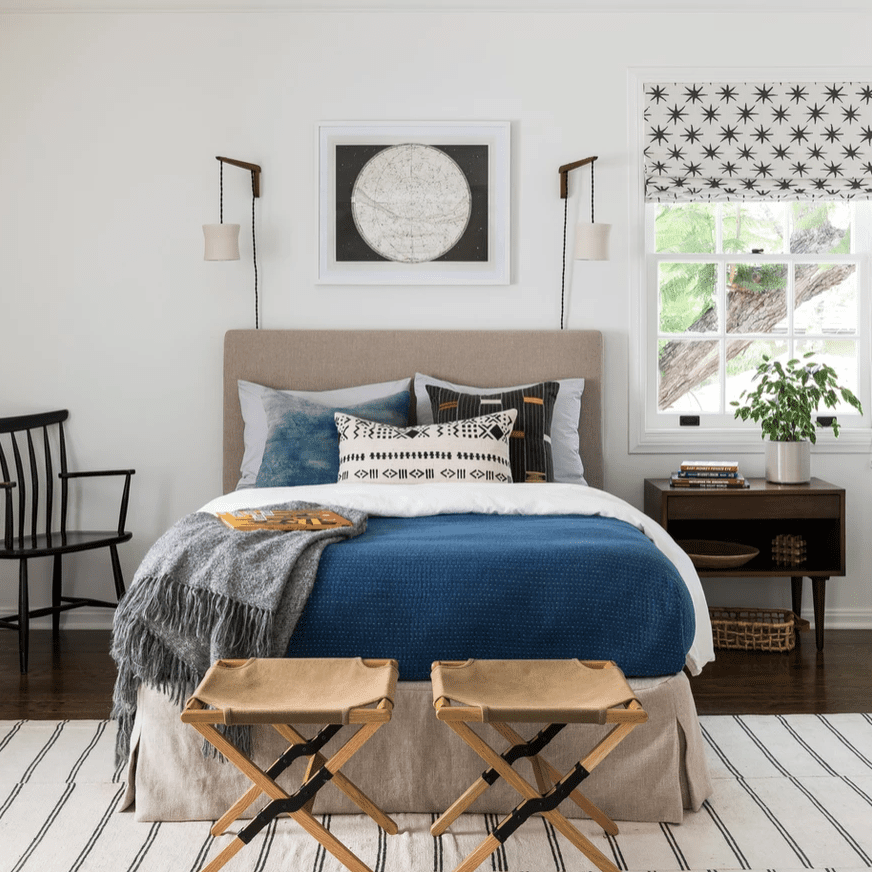 A maximalist bedroom with hanging sconces
