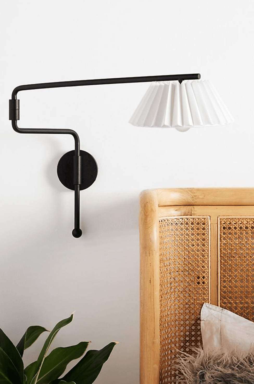 A wall-mounted sconce, currently for sale at Anthroplogie