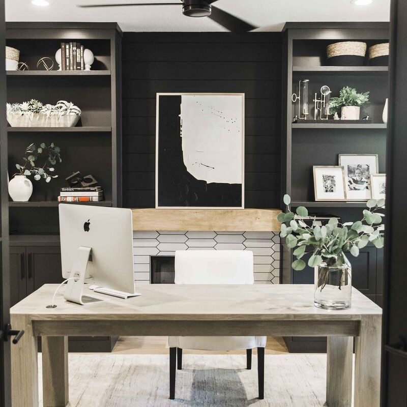 Desk with black bookcases behind it