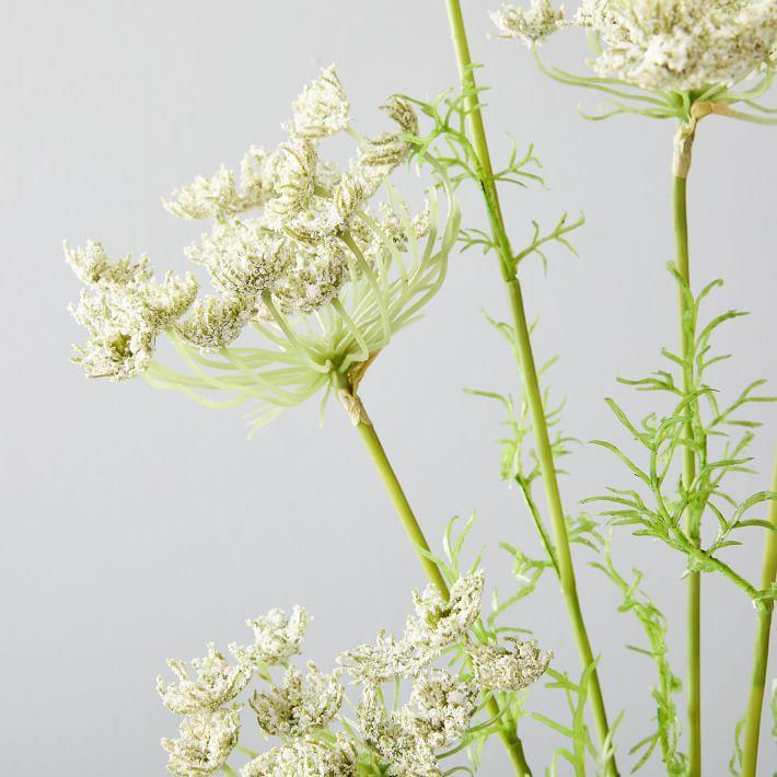 A faux Queen Anne's Lace flower stem.