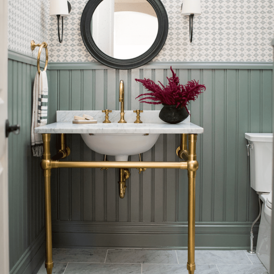 A half-bathroom with two-toned walls