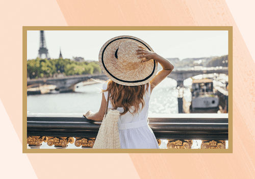 Girl looking at Eiffel Tower in France.