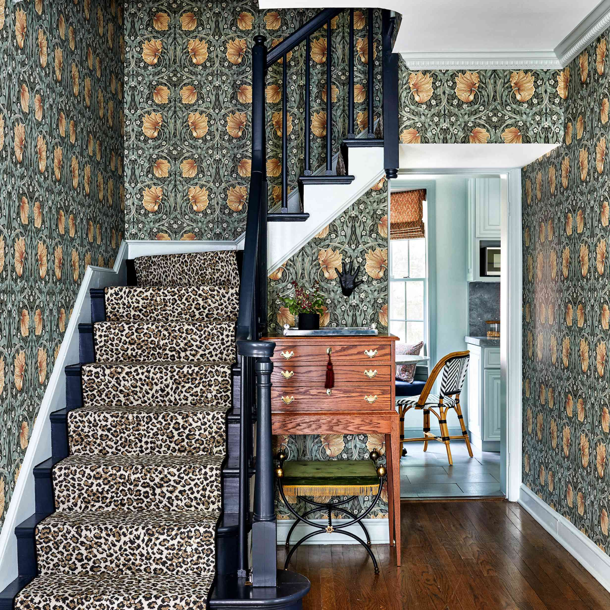 Entryway with animal print rug on staricase.