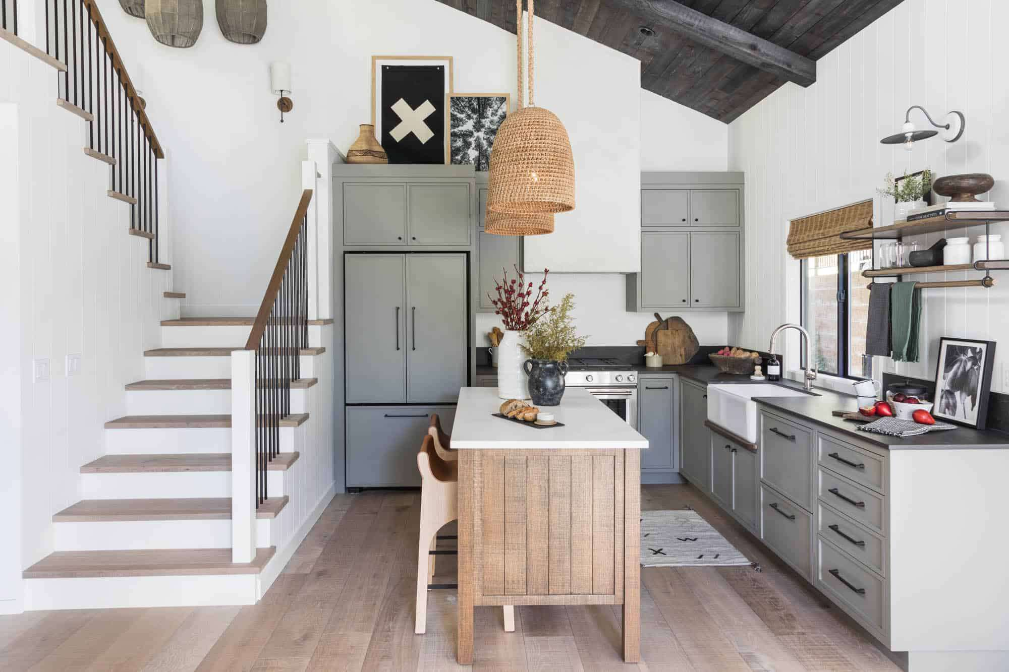 A kitchen with a portable kitchen island