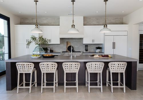 Kitchen with gray tile flooring.