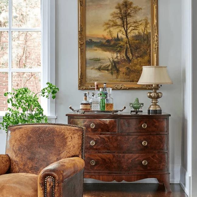 Vintage art above antique dresser.