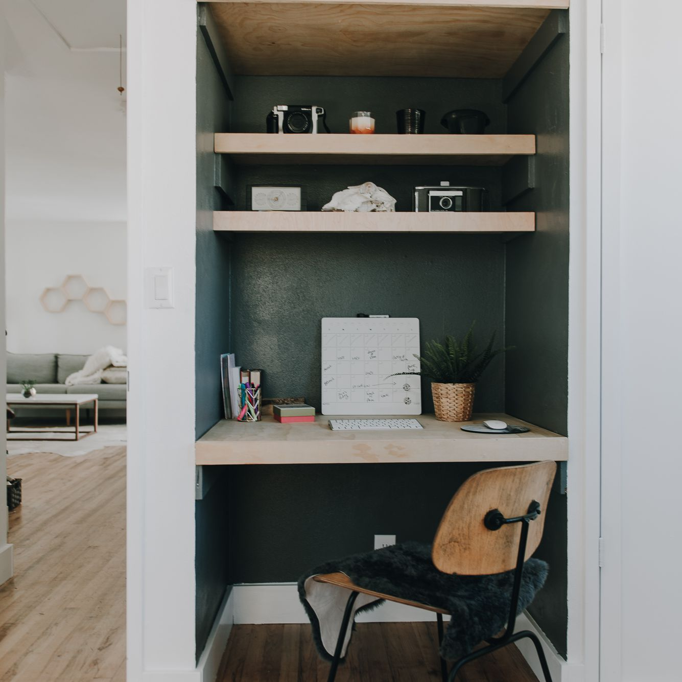 Closet turned home office space with floating desk and shelves