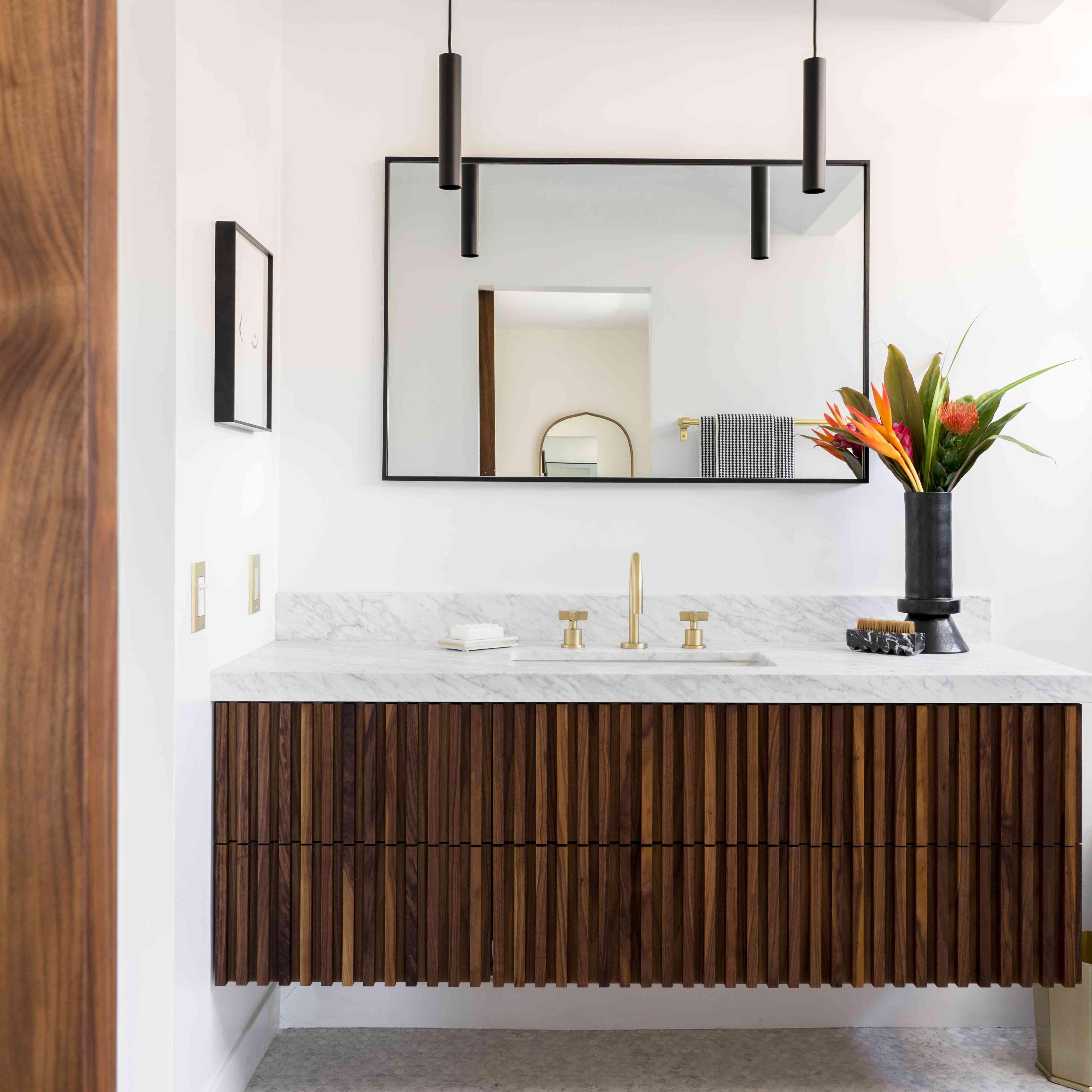 Bathroom vanity with sleek pendant lighting.