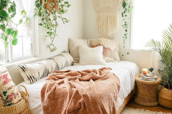 cozy bedroom with cozy blanket on bed
