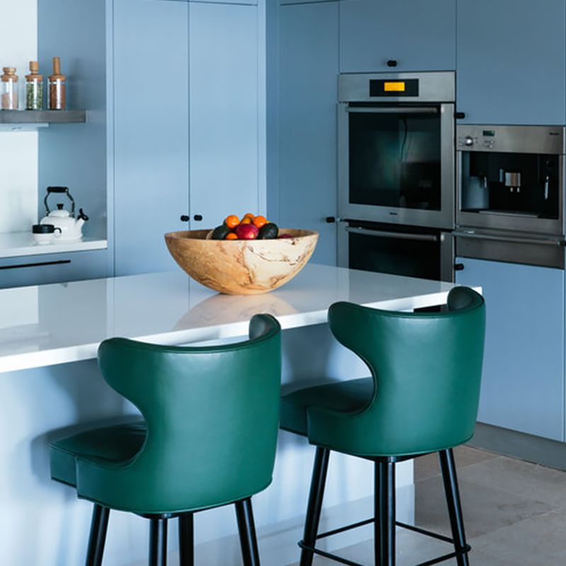 A midcentury modern-inspired kitchen with blue flat-panel cabinets.