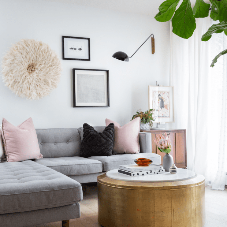 Living room with L-shaped sectional, round coffee table