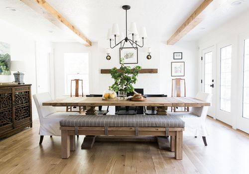 Modern rustic dining room with bench at table.