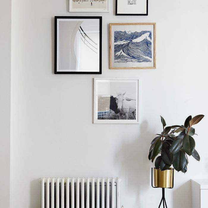 wall art and a tall planter
