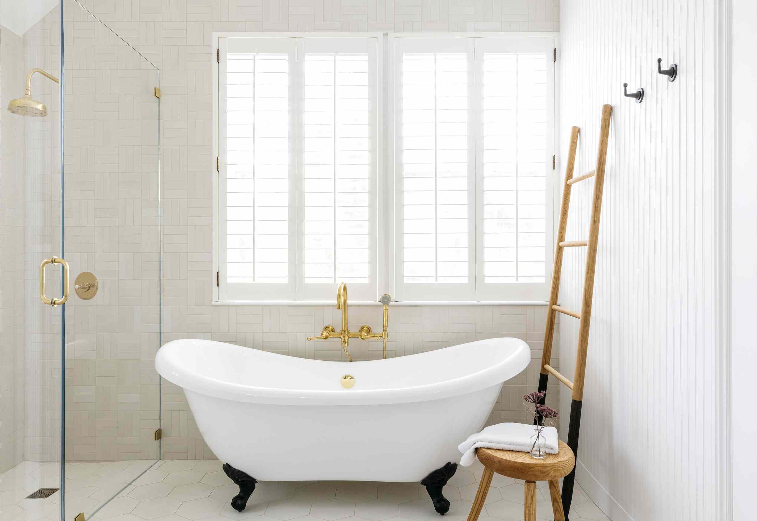 bathroom with clawfoot tub and ladder