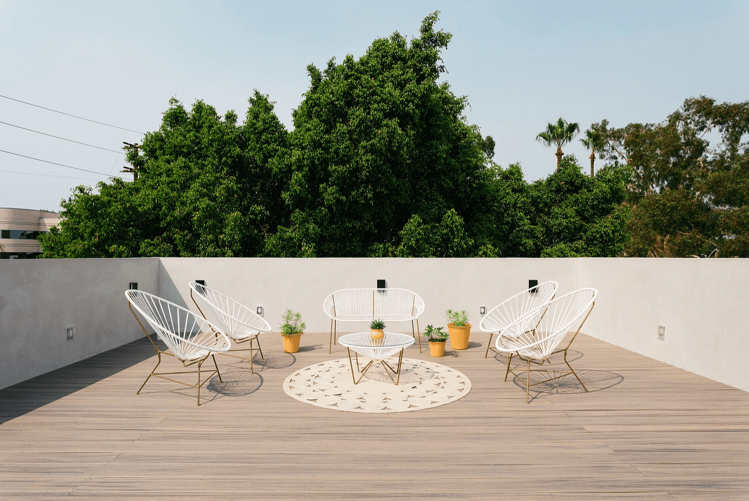 A rooftop deck decorated with matching modern furniture