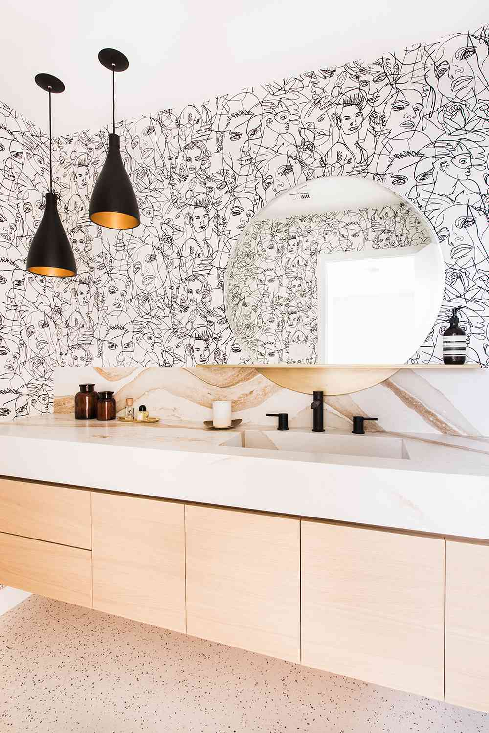 bathroom counter with hanging pendant lights