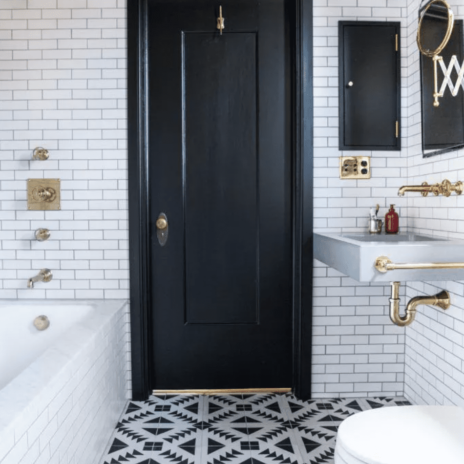 Southwestern motif-tiled bathroom with gold fixtures