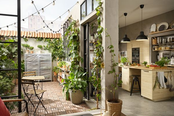 indoor outdoor living space with kitchen and balcony