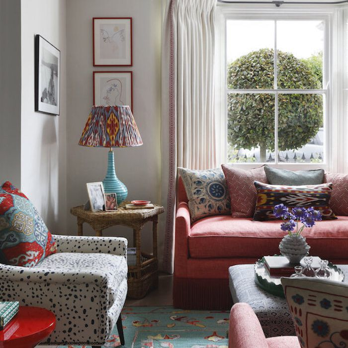 red and blue living room with different patterns used throughout