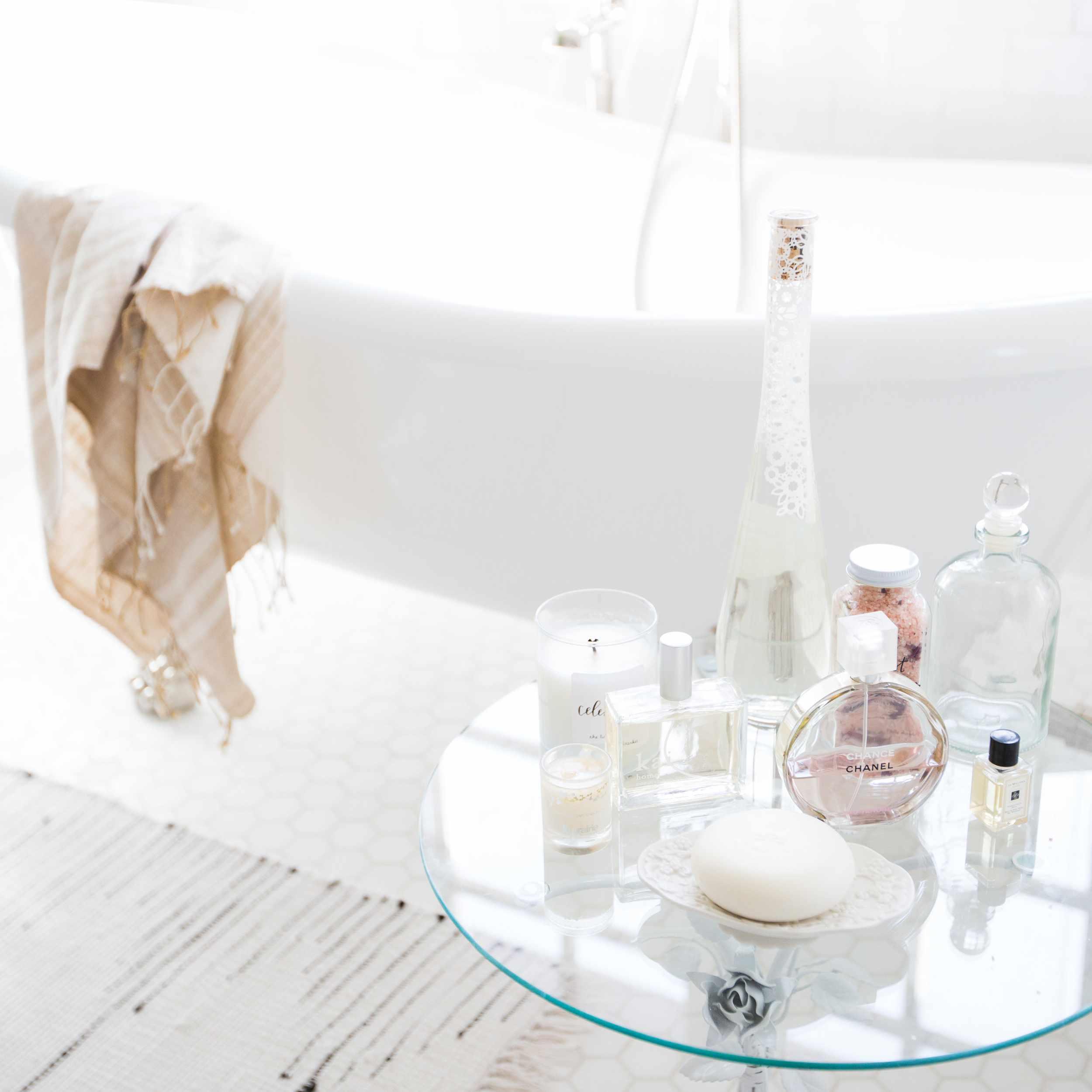 Perfumes on display in bathroom.
