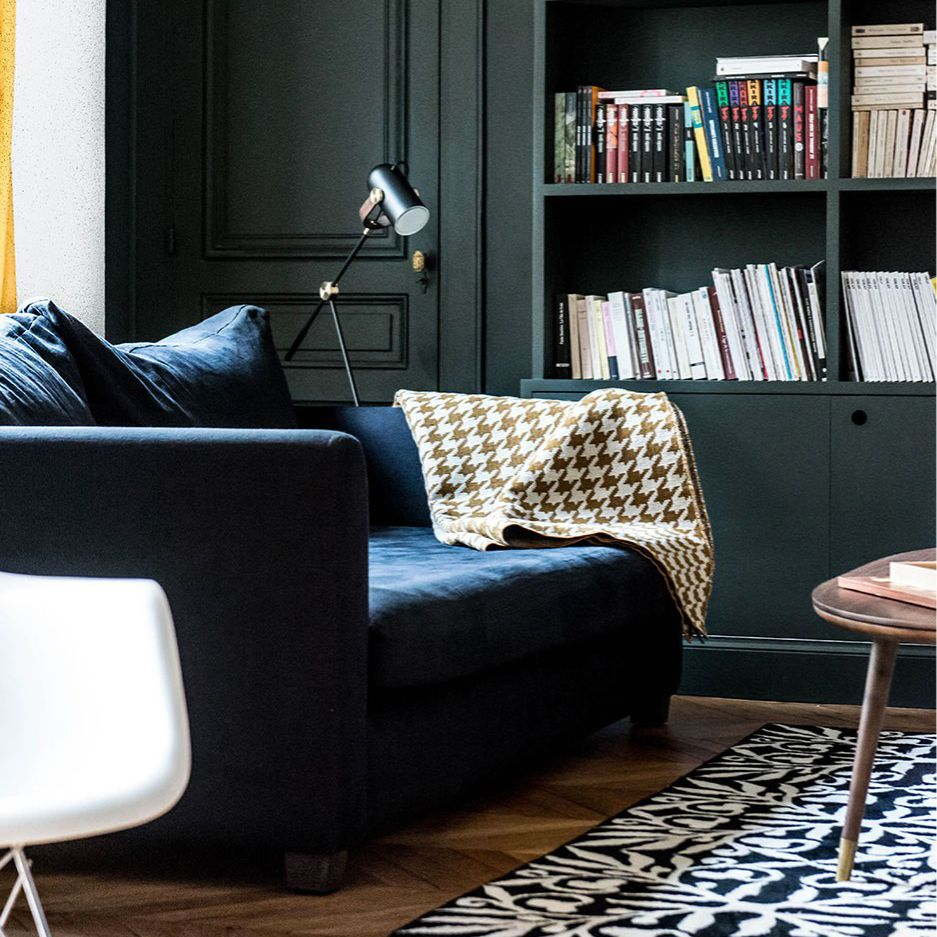 Masculine library with green bookcases