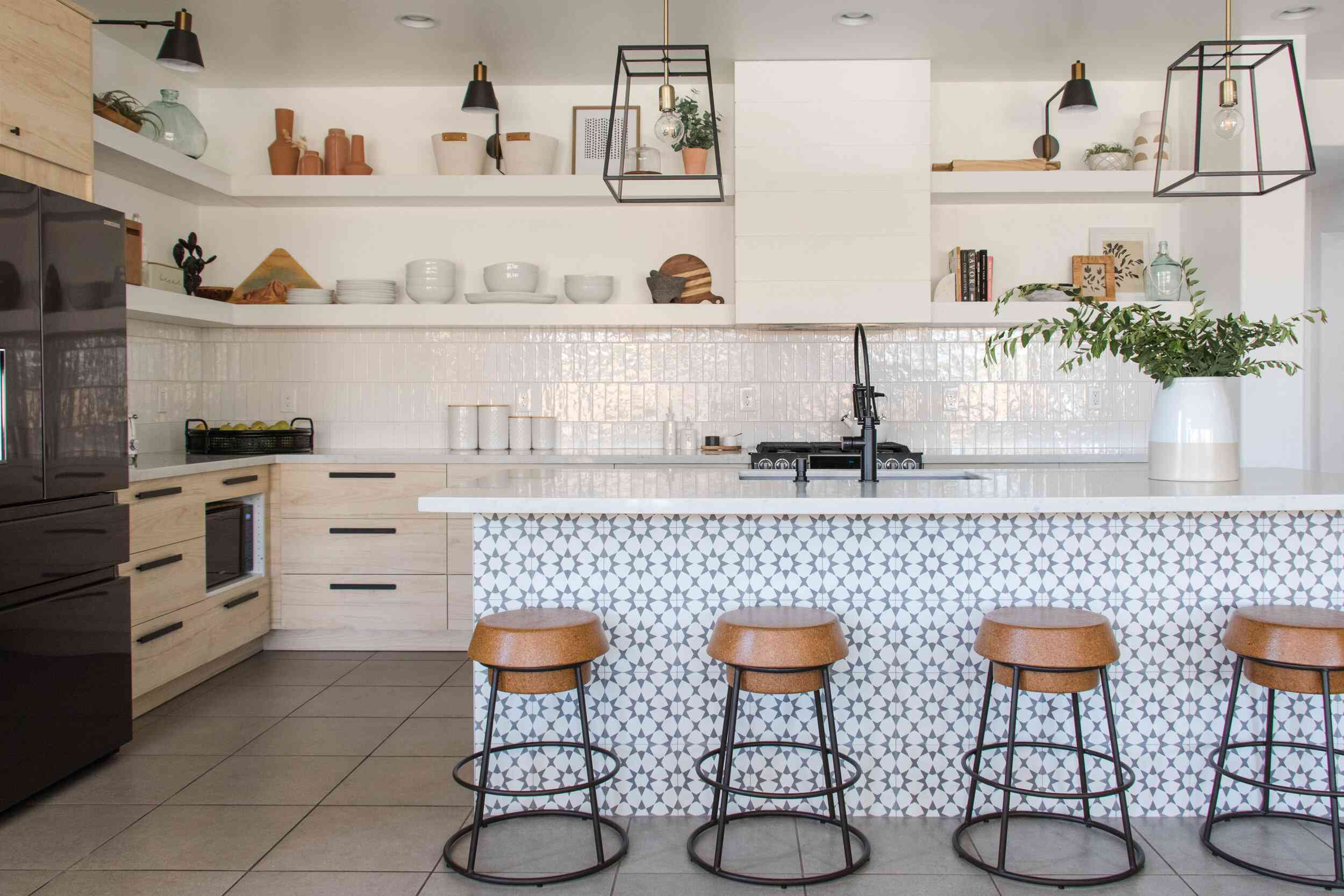 A white kitchen with a boldly tiled bar
